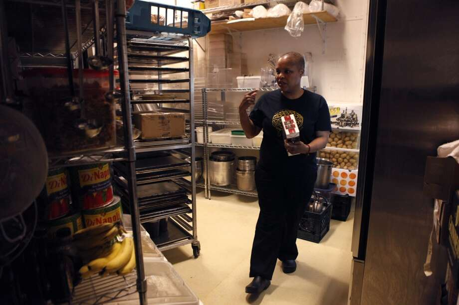 Chef Tanya Holland looks for items in storage before opening at Brown Sugar Kitchen in Oakland, Calif., on Sunday, February 2, 2014. Photo: The Chronicle