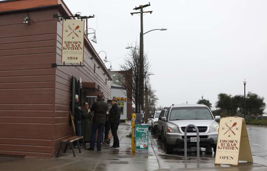A line waits outside Brown Sugar Kitchen during breakfast in Oakland, Calif., on Sunday, February 2, 2014. Photo: The Chronicle