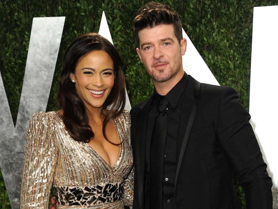 "Paula Patton and Robin Thicke may be separated now but once upon a time they were one of Hollywood's ""spiciest"" couples.  ""The spice is not our problem. We could probably take a few spices off the shelf."" Thicke told Elle Magazine.  Indeed, the couple like to get creative in the bedroom. When asked whether Patton ever listened to his music to get in the mood, Thicke replied: ""She likes to do it more than ever now. Sometimes she'll even play groupie for me.""  We sort of suspected the man who gave us the ""Blurred Lines"" video would say that.  Photo: Jordan Strauss, Associated Press"