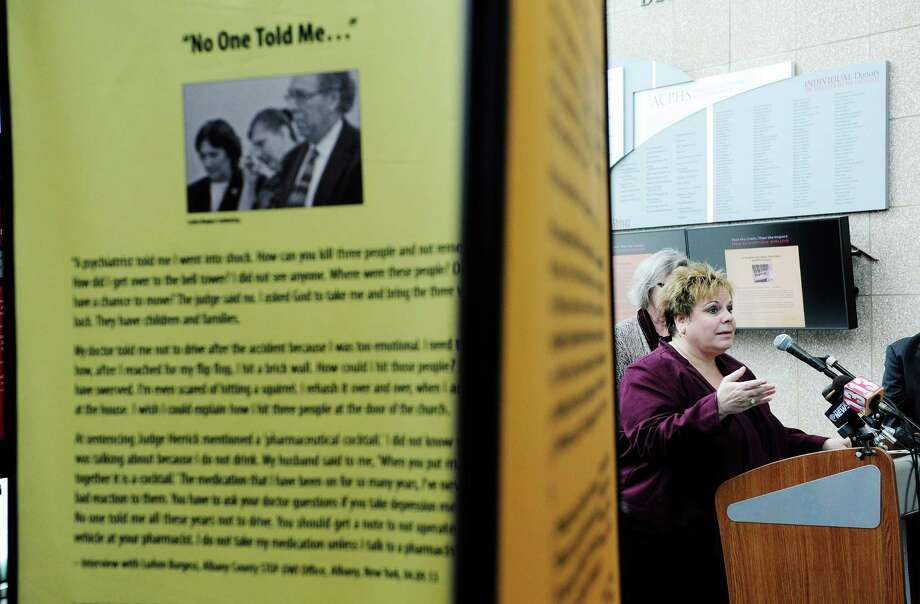 Cathy Pallozzi talks about her mother, Fran Pallozzi, at an event for an exhibit on drugged driving at the Albany College of Pharmacy and Health Sciences on Monday, March 10, 2014 in Albany, NY.  The exhibit tells the stories of several deaths in this area from people who were impaired by medications at the time of the accidents.   Fran Pallozzi and two other people were killed when they were struck by a vehicle driven by LuAnn Burgess who was driving with several medications in her system.  (Paul Buckowski / Times Union) Photo: Paul Buckowski / 00026056A