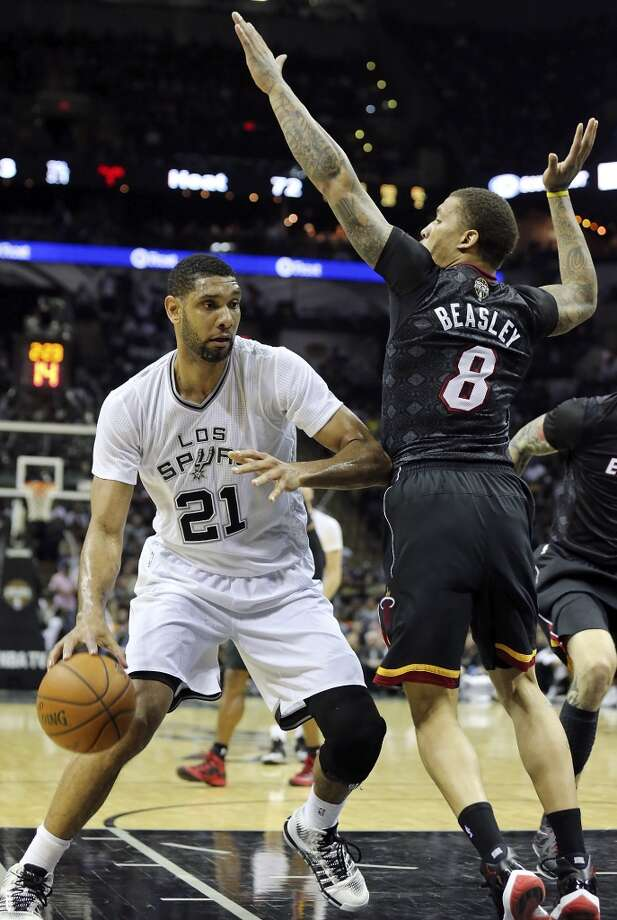 San Antonio Spurs' Tim Duncan looks for room around Miami Heat's Michael Beasley during second half action Thursday March 6, 2014 at the AT&T Center. The Spurs won 111-87. Photo: Edward A. Ornelas, San Antonio Express-News