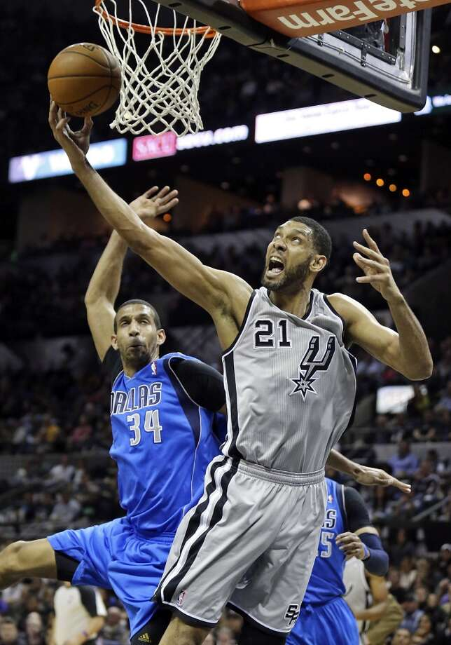 San Antonio Spurs' Tim Duncan shoots around Dallas Mavericks' Brandan Wright during second half action Sunday March 2, 2014 at the AT&T Center. Duncan was fouled on the play. The Spurs won 112-106. Photo: Edward A. Ornelas, San Antonio Express-News