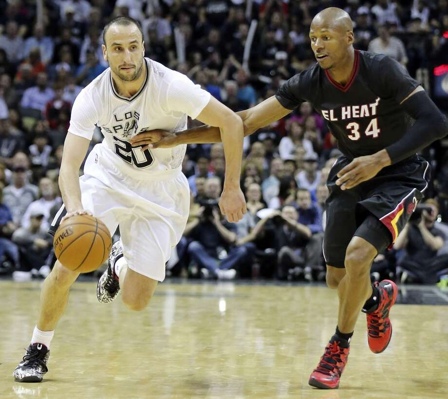 San Antonio Spurs' Manu Ginobili drives around Miami Heat's Ray Allen during second half action Thursday March 6, 2014 at the AT&T Center. The Spurs won 111-87. Photo: Edward A. Ornelas, San Antonio Express-News