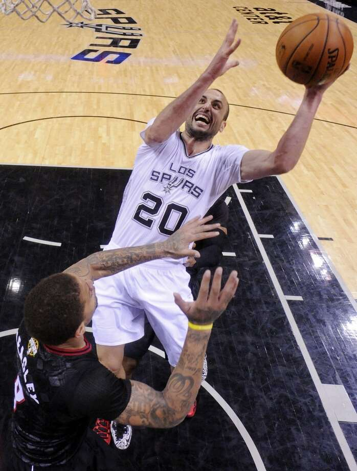 San Antonio Spurs' Manu Ginobili shoots over Miami Heat's Michael Beasley during second half action Thursday March 6, 2014 at the AT&T Center. The Spurs won 111-87. Photo: Edward A. Ornelas, San Antonio Express-News