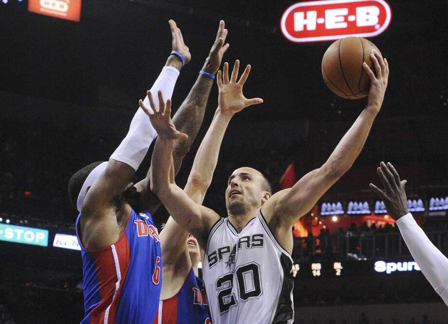 Manu Ginobili of the San Antonio Spurs attempts a layup against the Detroit Pistons during NBA action in the AT&T Center on Wednesday, Feb. 26, 2014. Photo: Billy Calzada, San Antonio Express-News