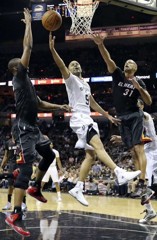 San Antonio Spurs' Tony Parker shoots between Miami Heat's Chris Bosh (left) and Miami Heat's Shane Battier during first half action Thursday March 6, 2014 at the AT&T Center. Photo: Edward A. Ornelas, San Antonio Express-News
