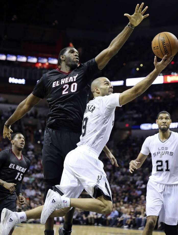 San Antonio Spurs' Tony Parker shoots around Miami Heat's Greg Oden during first half action Thursday March 6, 2014 at the AT&T Center. Photo: Edward A. Ornelas, San Antonio Express-News