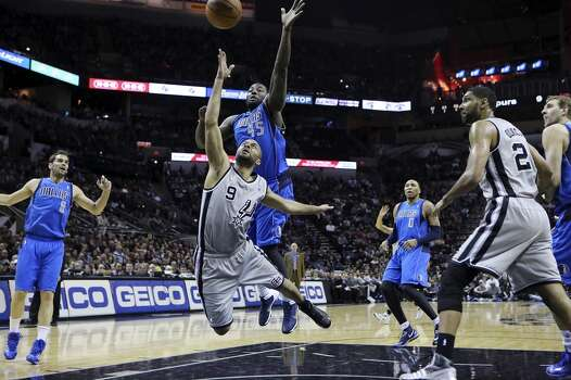 San Antonio Spurs' Tony Parker shoots around Dallas Mavericks' DeJuan Blair during first half action Sunday March 2, 2014 at the AT&T Center. Photo: Edward A. Ornelas, San Antonio Express-News
