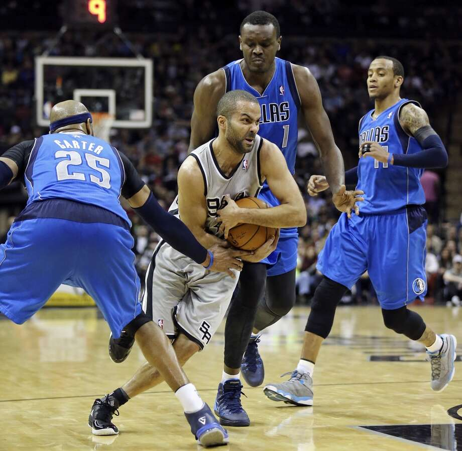 San Antonio Spurs' Tony Parker looks for room between Dallas Mavericks' Vince Carter (from left), Samuel Dalembert, and Monta Ellis during second half action Sunday March 2, 2014 at the AT&T Center. The Spurs won 112-106. Photo: Edward A. Ornelas, San Antonio Express-News