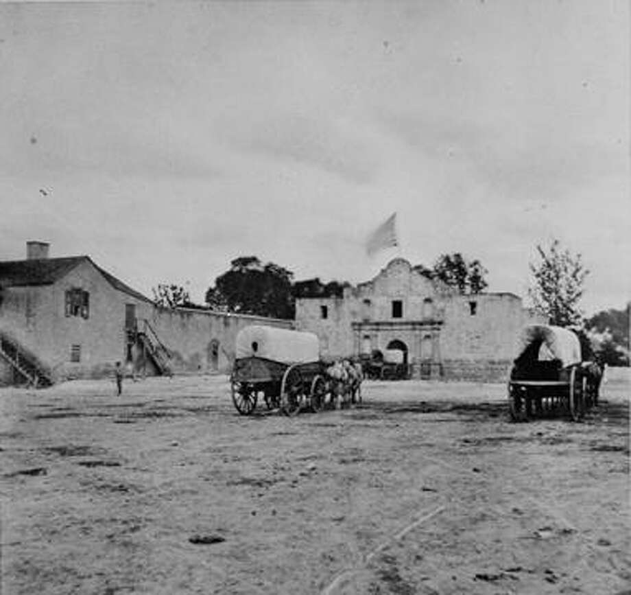Just like it is for San Antonio Express-News employees today, the Alamo was a familiar sight to Express workers in the latter half of the 1860s. Parking on its grounds now is prohibited, however. Photo: Institute Of Texan Cultures