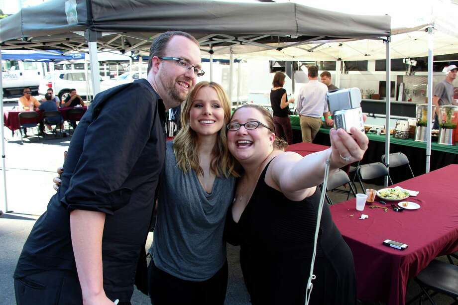 """Kickstarter backers Jake Kallman and Erin Katzer, right, take a photo with Kristen Bell on the set of the film """"Veronica Mars,"""" based on the cult 2000s TV series. Nearly a year after 91,000 donors contributed about $5.7 million to revive the series after it was canceled in 2007, the movie will be released Friday in theaters and via video on demand. Photo: (Ivan Askwith, HO / IVAN ASKWITH"""