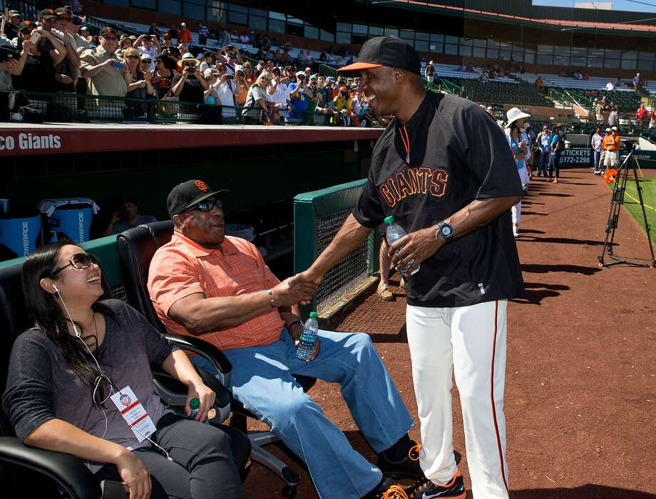 Former Giants outfielder Barry Bonds (right) greets Hall of Famer Willie McCovey during batting practice before a game against the Chicago Cubs at Scottsdale Stadium. Bonds started a seven-day coaching stint on Monday in Arizona. Photo: Mark J. Rebilas, Reuters