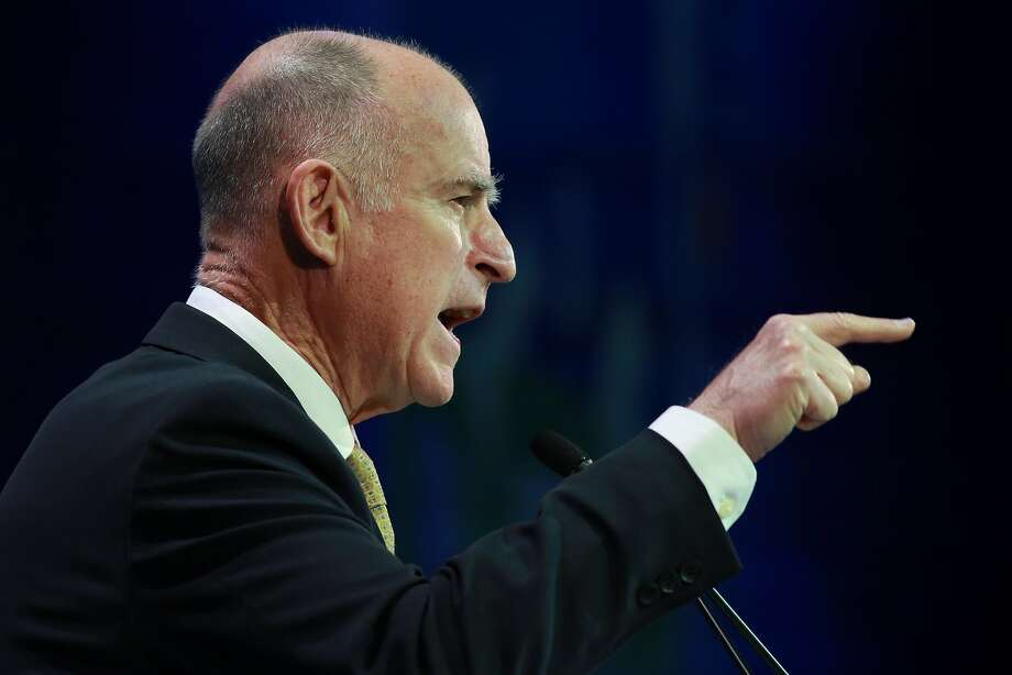 Gov. Jerry Brown speaks at the California Democratic Party convention in L.A., where fracking opponents heckled him. Photo: Jonathan Alcorn, For The Chronicle