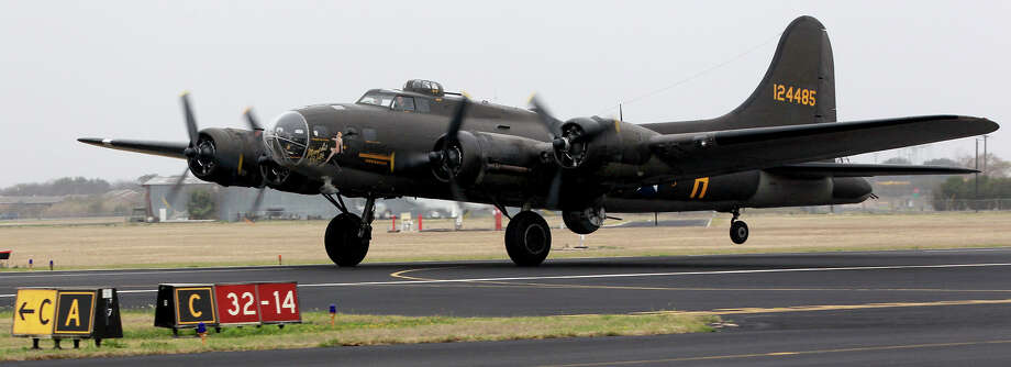 "The ""Memphis Belle"" B-17G World War II era bomber takes off Monday March 10, 2014 at Stinson Field. The vintage bomber is operated by the Liberty Foundation and will be in San Antonio along with a P-51 Mustang until next Sunday. Photo: JOHN DAVENPORT, SAN ANTONIO EXPRESS-NEWS / ©"