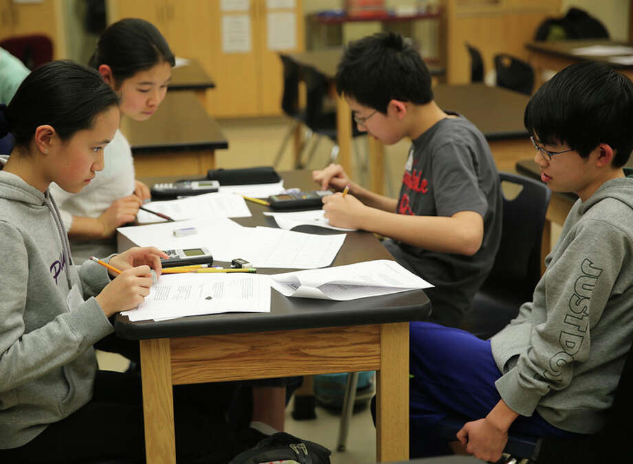 The Eastern Middle School math team recently won the state MATHCOUNTS competition. Seen here practicing for the big showdown are, clockwise, from top left are team members, Michelle Woo, Henry Shi, Steven Ma and Jovita Li. Photo: Contributed Photo / Greenwich Time