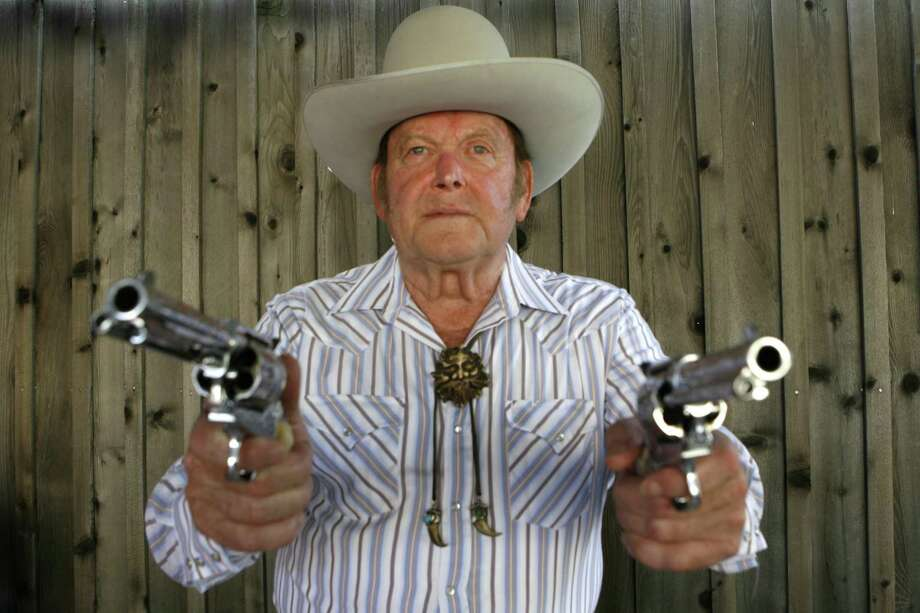 Joe Bowman: Joe Bowman, an internationally know Wild West marksmen. He performs in Wild West touring shows here and in Europe. He can hit an aspirin tossed in the air and a playing card's edge from 50 paces. Photo by Carlos Antonio Rios  Houston Chronicle Photo: Carlos Antonio Rios, Staff Photographer / Houston Chronicle