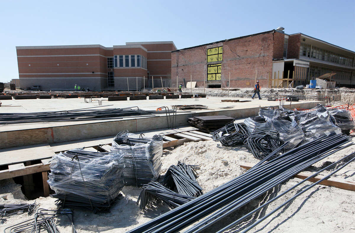 Work continues on the foundation for the new cafeteria at Highlands High School. The school's architecture students were invited to tour the site in an unusual up-close look at construction work.
