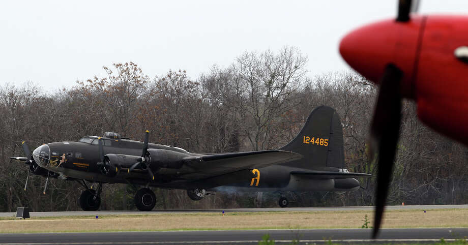 "The ""Memphis Belle"" B-17G World War II era bomber lands Monday March 10, 2014 at Stinson Field. The vintage bomber is operated by the Liberty Foundation and will be in San Antonio along with a P-51 Mustang until next Sunday. Photo: JOHN DAVENPORT, SAN ANTONIO EXPRESS-NEWS / ©San Antonio Express-News/Photo may be sold to the public"