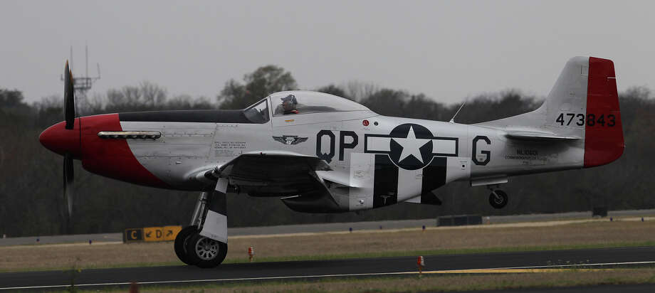 A P-51 Mustang lands Monday March 10, 2014 at Stinson Field. The plane will be in San Antonio along with a B-17 bomber until next Sunday. In the pilot's seat is Tony Stein. Photo: JOHN DAVENPORT, SAN ANTONIO EXPRESS-NEWS / ©San Antonio Express-News/Photo may be sold to the public