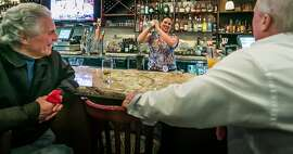 Moelani Maestrini shakes a cocktail for customers at Noelani's in San Carlos, Calif., on Friday, March 7th, 2014.