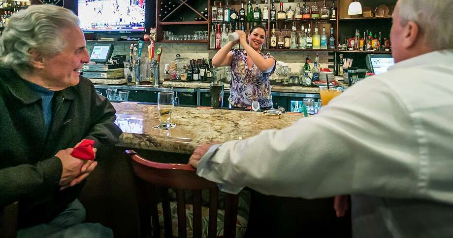 Noelani Maestrini shakes a drink. Photo: John Storey, Special To The Chronicle