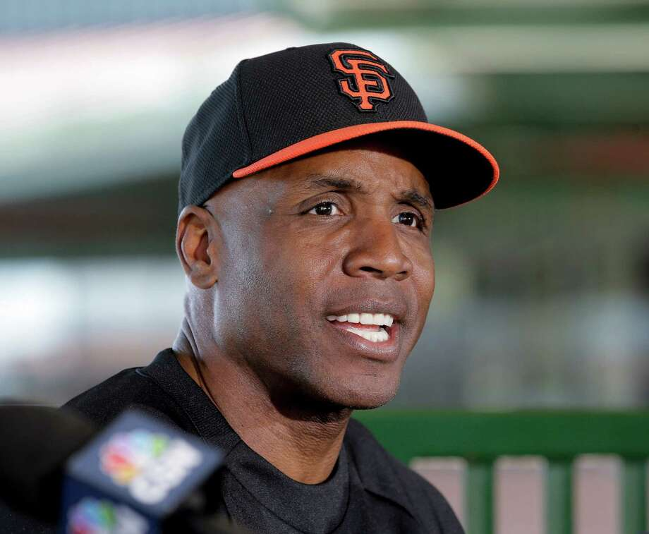 San Francisco Giants former player Barry Bonds speaks during a news conference before a spring training baseball game in Scottsdale, Ariz., Monday, March 10, 2014. Bonds starts a seven day coaching stint today. (AP Photo/Chris Carlson) Photo: Chris Carlson, Associated Press / AP