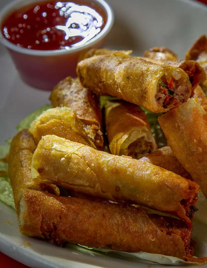 Diners have lunch at the casual American Bull Sports Bar & Grill; fried lumpia is one of many appetizer choices on the menu. Photo: John Storey, Special To The Chronicle