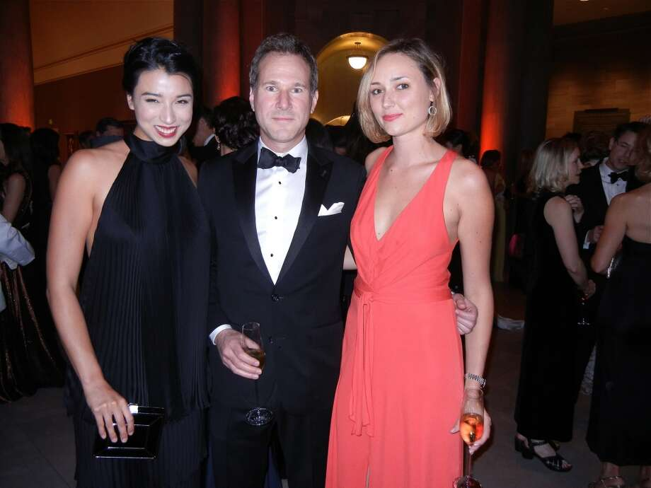 Model-designer Lily Kwong (at left) with film producer Paul Ruehl and Dorothy Woods at the Mid-Winter Gala. Photo: Catherine Bigelow