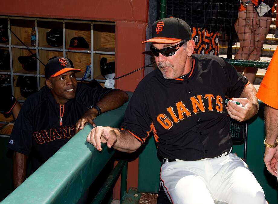 Mar 10, 2014; Scottsdale, AZ, USA; San Francisco Giants former outfielder Barry Bonds (left) talks with manager Bruce Bochy during the game against the Chicago Cubs at Scottsdale Stadium. Mandatory Credit: Mark J. Rebilas-USA TODAY Sports Photo: Mark J. Rebilas, Reuters