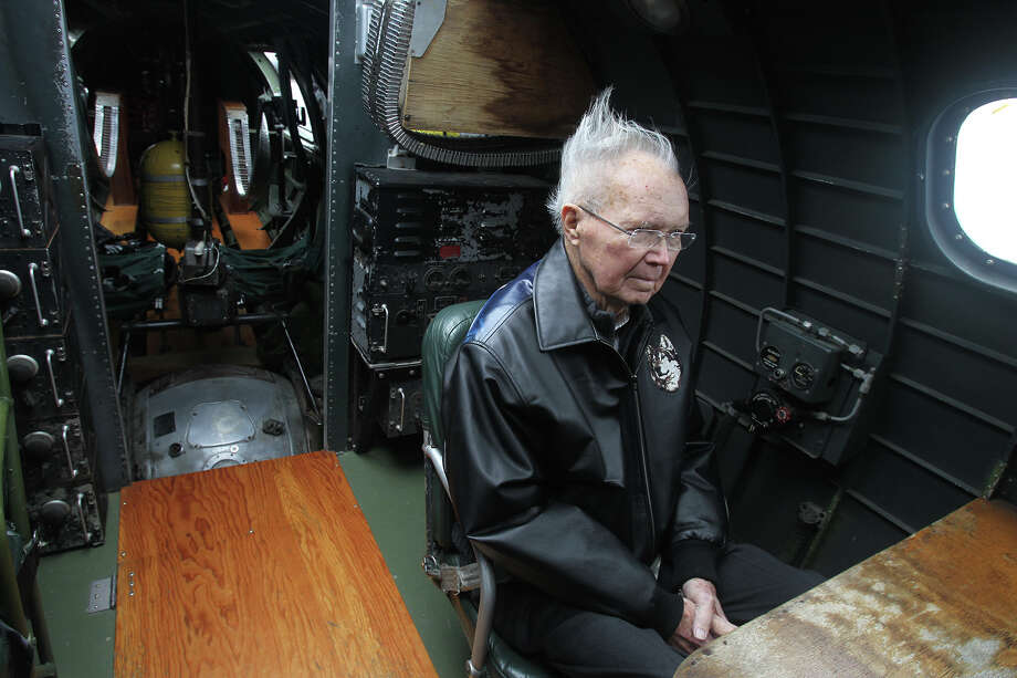 "John Alebis,87, sits at the radio operators desk while the ""Memphis Belle"" B-17 WWII era bomber flies over San Antonio Monday March 10, 2014. Alebis, a WWII veteran, was a B-17 waist gunner who flew in B-17s out of England. The ""Memphis Belle"" will be in San Antonio until nest Sunday. Photo: JOHN DAVENPORT, SAN ANTONIO EXPRESS-NEWS / ©San Antonio Express-News/Photo may be sold to the public"