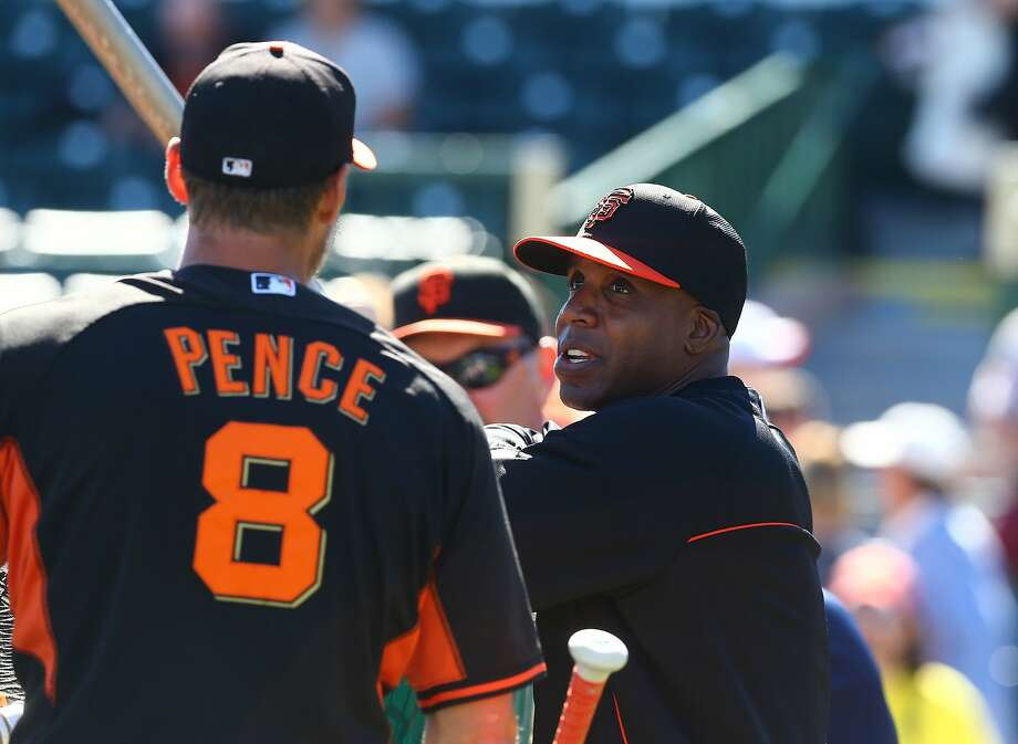 Mar 10, 2014; Scottsdale, AZ, USA; San Francisco Giants former outfielder Barry Bonds (right) talks with outfielder Hunter Pence during batting practice prior to the game against the Chicago Cubs at Scottsdale Stadium. Mandatory Credit: Mark J. Rebilas-USA TODAY Sports Photo: Mark J. Rebilas, Reuters