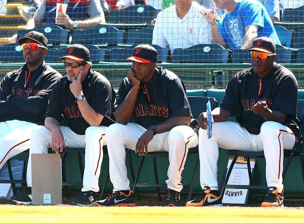 Mar 10, 2014; Scottsdale, AZ, USA; San Francisco Giants former outfielder Barry Bonds (center) watches during the game against the Chicago Cubs at Scottsdale Stadium. Mandatory Credit: Mark J. Rebilas-USA TODAY Sports