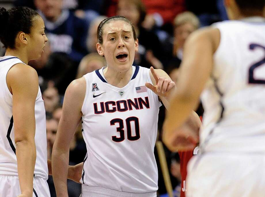 Connecticut's Breanna Stewart (30) calls out to teammate Kaleena Mosqueda-Lewis, right, as Kia Stokes, left, looks on, after Stewart was fouled during the first half of an NCAA college basketball game in the finals of the American Athletic Conference women's basketball tournament, Monday, March 10, 2014, in Uncasville, Conn. Photo: Jessica Hill, AP / Associated Press