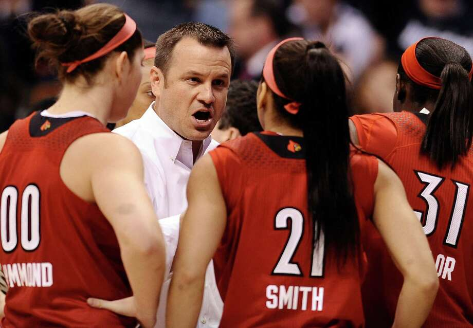 Louisville head coach Jeff Walz, center, talks with Louisville's Sara Hammond (00), Bria Smith (21), and Asia Taylor (31) during the first half of an NCAA women's college basketball game in the finals of the American Athletic Conference  basketball tournament, Monday, March 10, 2014, in Uncasville, Conn. Photo: Jessica Hill, AP / Associated Press