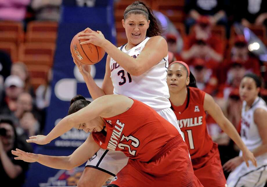 Connecticut's Stefanie Dolson, top, keeps the ball from Louisville's Shoni Schimmel, bottom, during the first half of an NCAA women's college basketball game in the finals of the American Athletic Conference basketball tournament, Monday, March 10, 2014, in Uncasville, Conn. Photo: Jessica Hill, AP / Associated Press
