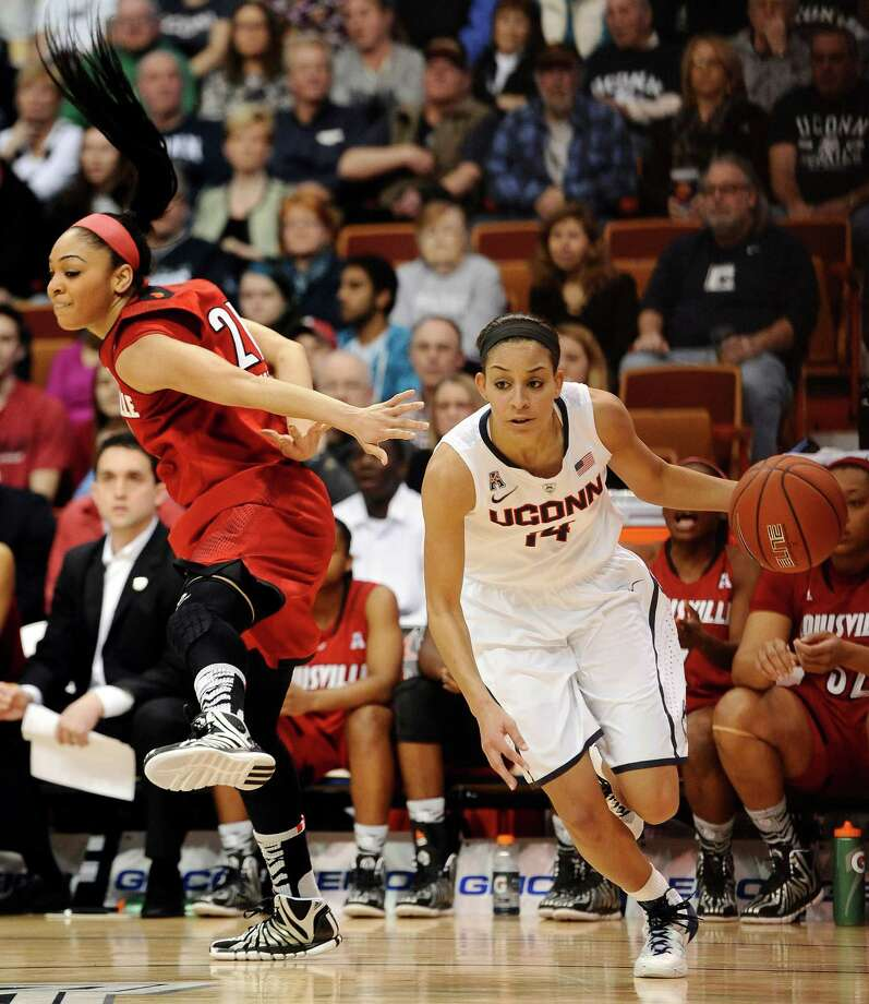 Connecticut's Bria Hartley, right, drives past  Louisville's Bria Smith, left, during the first half of an NCAA college basketball game in the finals of the American Athletic Conference women's basketball tournament, Monday, March 10, 2014, in Uncasville, Conn. Photo: Jessica Hill, AP / Associated Press