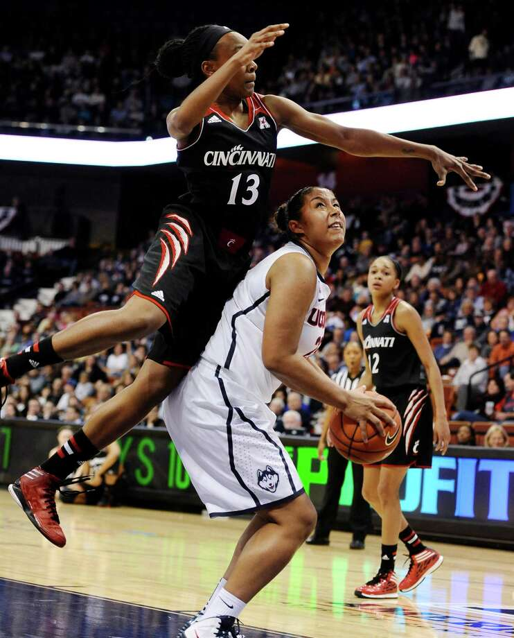 Cincinnati's Brandey Tarver, left, fouls Connecticut's Kaleena Mosqueda-Lewis, right, during the first half of an NCAA college basketball game in the quarterfinals of the American Athletic Conference women's basketball tournament, Saturday, March 8, 2014, in Uncasville, Conn. Photo: Jessica Hill, AP / Associated Press