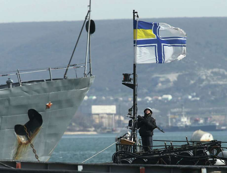 The Ukrainian warship Ternipol (foreground) is anchored next to a Russian ship in Sevastopol. Russian warships are preventing the Ternipol and the larger Slavutych from departing Crimea's Black Sea port. Photo: Sean Gallup / Getty Images / 2014 Getty Images