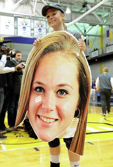 UAlbany's Sarah Royals holds a cardboard cut-out of her head with a band-aid under her eye after her
