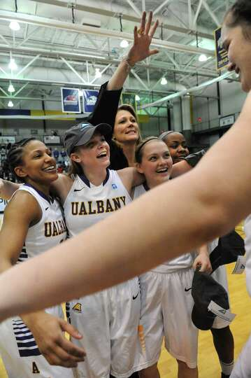 UAlbany's Megan Craig, right, comes in for a hug as she celebrates with her team after defeating Sto