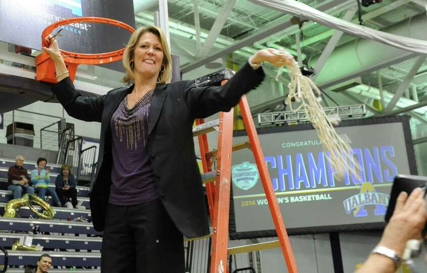 UAlbany head coach Katie Abrahamson-Henderson swings the net she cut down after her team defeated St