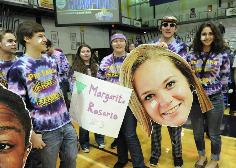 UAlbany's band members hold a cardboard cut-out of Sarah Royals' head with a band-aid under her eye