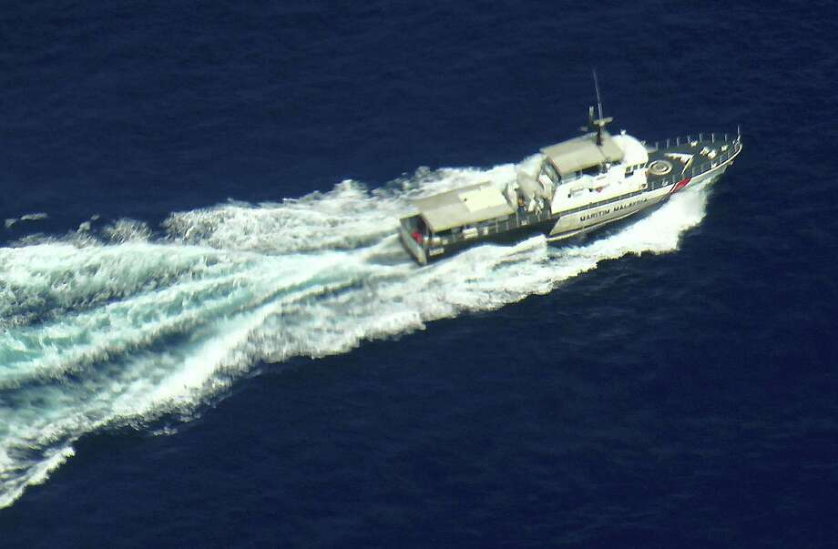 A  Malaysian Maritime Enforcement Agency patrol vessel searches for signs of Malaysia Airlines Flight MH370, which disappeared early Saturday. Photo: Handout / 2014 Malaysian Maritime Agency
