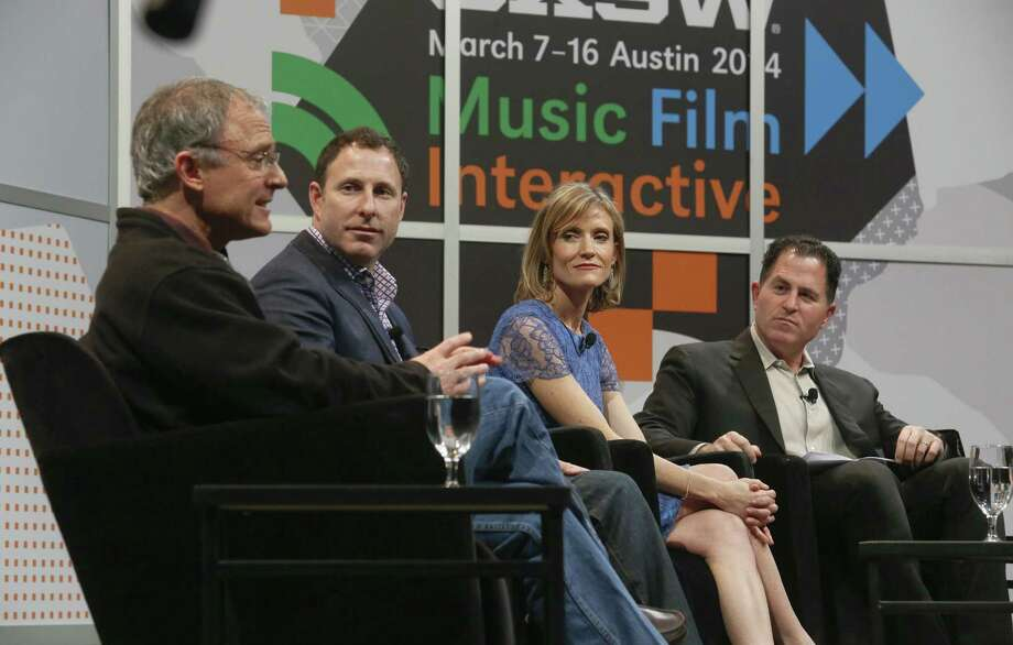 Dell Inc. founder Michael Dell (right) swaps startup stories and advice with fellow entrepreneurs TripAdvisor founder Stephen Kaufer (from left), Shutterfly CEO Jeffrey Housenbold and XO Group co-founder Carley Roney at SXSW Interactive. Photo: Jack Plunkett / Associated Press / AP