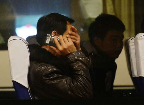 Relatives of passengers from the missing Malaysia Airlines Boeing 777-200 plane wait inside a bus at the Lido Hotel in Beijing on March 10, 2014.   The desperate search for a Malaysian jet which vanished carrying 239 people was significantly expanded on Monday with frustrations mounting over the failure to find any trace of the plane. The initial zone spread over a 50 nautical mile radius around the point where flight MH370 disappeared over the South China Sea in the early hours of Saturday morning, en route from Kuala Lumpur to Beijing. Photo: Mark Ralston, AFP/Getty Images
