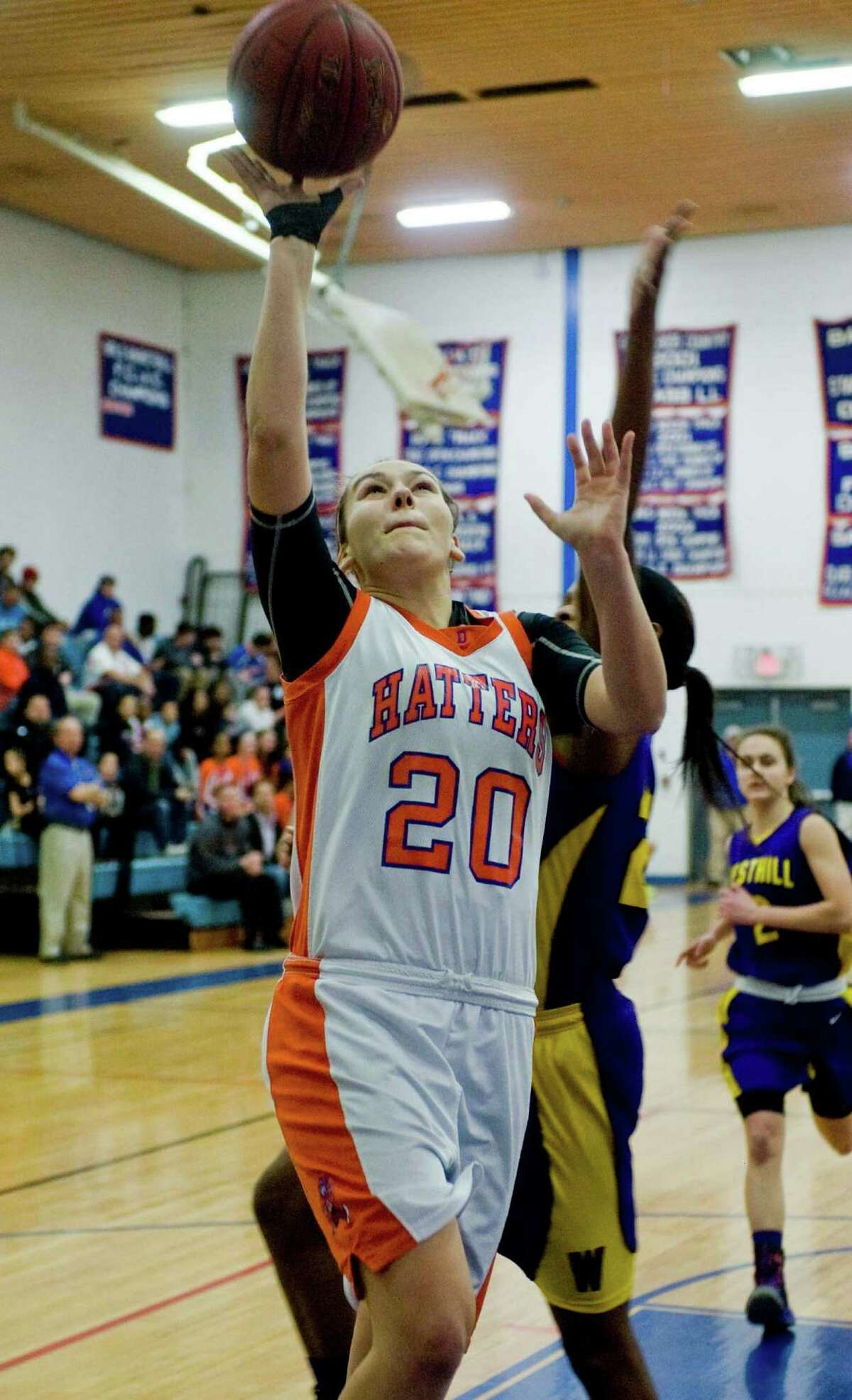 Danbury High School Forward Allie Smith goes up to the basket during the Class LL Girls Basketball Quarterfinals against Westhill High School, played at Danbury. Monday, March 10, 2014