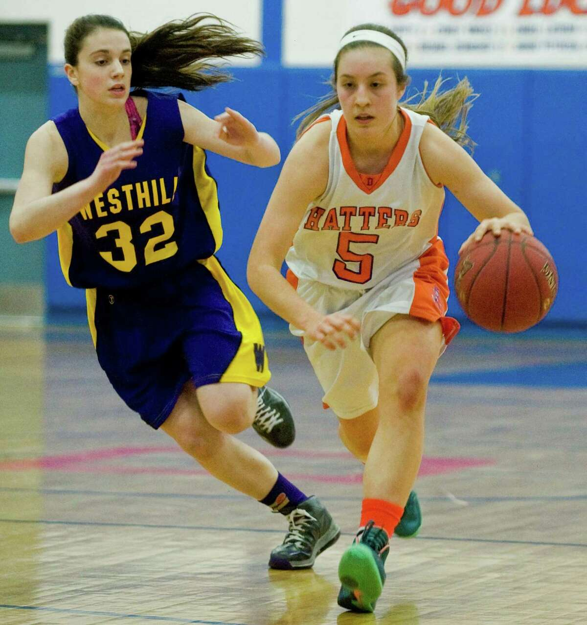 Westhill High School Guard Olivia Wise tries to chase down Danbury High School Guard Rachel Gartner during the Class LL Girls Basketball Quarterfinals against Westhill High School, played at Danbury. Monday, March 10, 2014