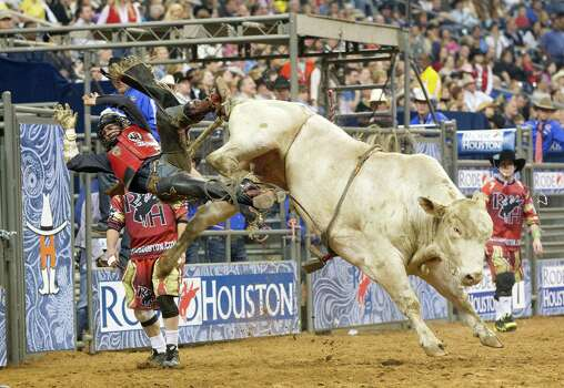Bobby Welsh is thrown off by a bull during the Bull Riding event during the first round of the Rodeo Houston BP Super Series lll at the Houston Livestock Show and Rodeo at Reliant Stadium Monday, March 10, 2014, in Houston. Photo: Johnny Hanson, Houston Chronicle / © 2014  Houston Chronicle