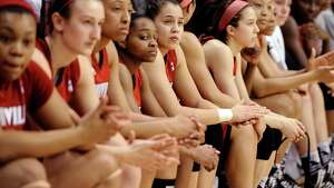 The Louisville Cardinal bench watches as UConn accepts their trophy for winning an NCAA college basketball game in the finals of the American Athletic Conference women's basketball tournament, Monday, March 10, 2014, in Uncasville, Conn. Connecticut won 72-52.