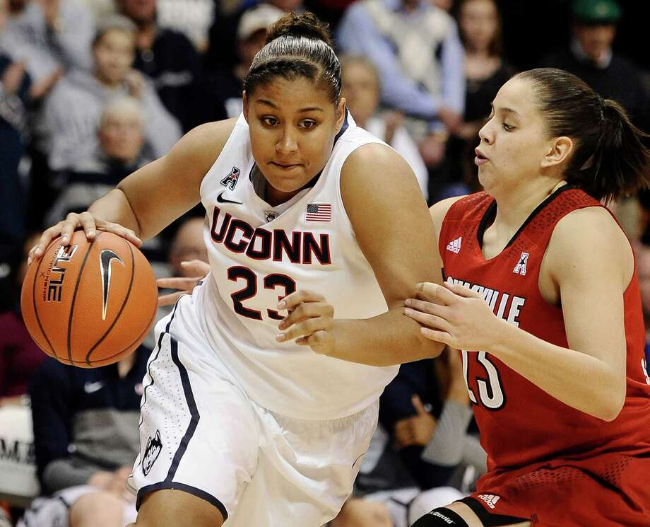 Connecticut's Kaleena Mosqueda-Lewis, left, drives past Louisville's Shoni Schimmel during the second half of an NCAA college basketball game in the finals of the American Athletic Conference women's basketball tournament, Monday, March 10, 2014, in Uncasville, Conn. Connecticut won 72-52. Photo: Jessica Hill, AP / Associated Press